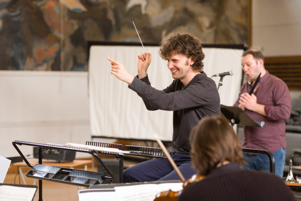 Nicholas Collon laughing in rehearsal